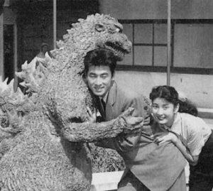 The_Original_Godzilla_Hugs_two_Japanese_People