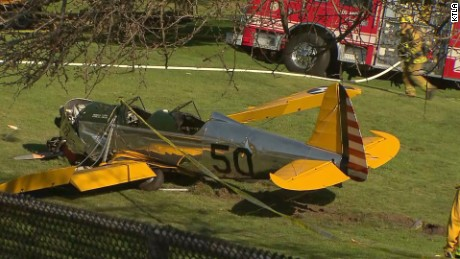 Harrison Ford crash land's dead plane on 8th hole.