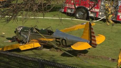 Harrison Ford crash land's dead plane on 8th hole.